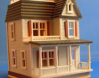 Dollhouse Miniature; 144th scale Miniature Blue House by, Millie August 1981.  Item #D252.
