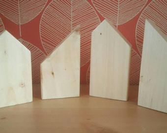Plain wooden house shapes, imaginitive play, small world play.