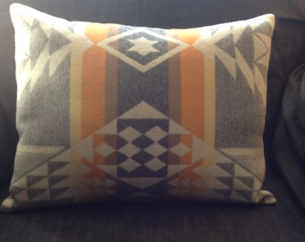 """Throw Pillow: Native American Inspired Pendleton wool in tones of slate, ivory, yellow, golden, mandarin, and russet, 18""""x 14""""."""