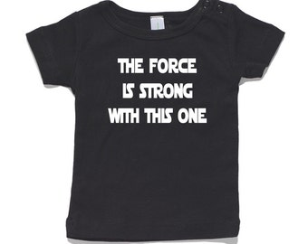 The Force Is Strong With This One Baby T-Shirt 100% Cotton white and black 0-24 months sizes funny newborn birth star wars