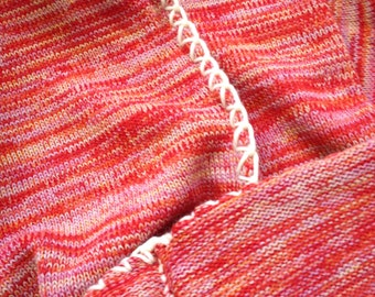 Hand knitted blanket with crochet edges