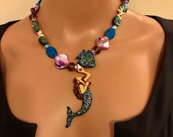 Auburn haired Mermaid statement necklace w fish w blues , abalone etc 17&1/2 inches