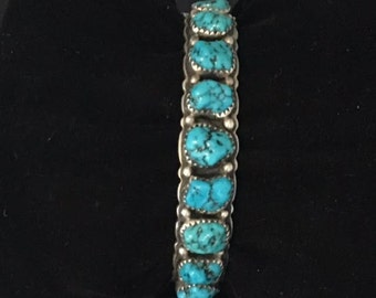 Vintage Orville Tsinnie Southwestern silver and turquoise bracelet