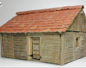 Scale model wooden hut kit. 28mm / 1:56, polyurethane resin, multi-part kit with 39 pieces.