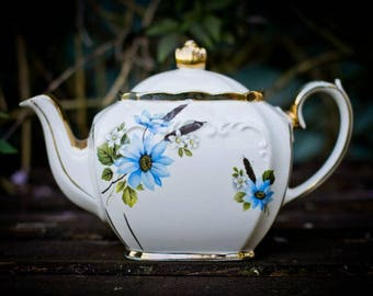Lovely cube shaped Sadler teapot with blue flower and foliage design.
