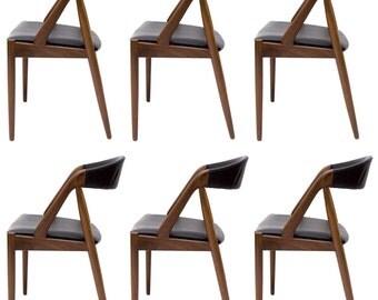 A set of 6 Kai Kristiansen teak chairs, Danish modern, mid century