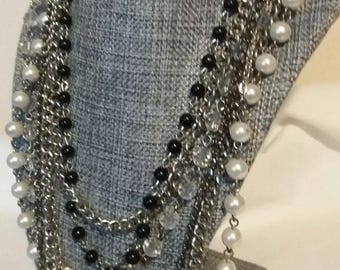 Boho Vintage Style layered silver toned necklace .  Black, clear and pearled beads.