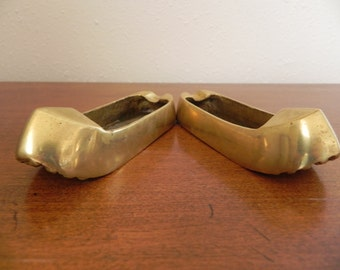 A Pair of Matching Vintage Brass Shoe Ashtrays