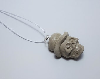 Skull concrete pendant with cord