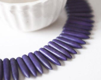 10 tips/purple spikes in Howlite gemstone
