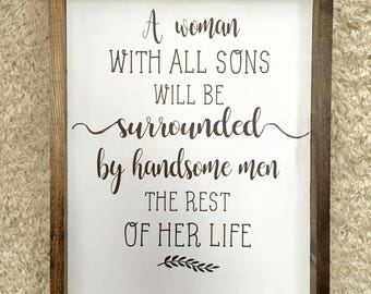 A woman with all sons framed wooden sign