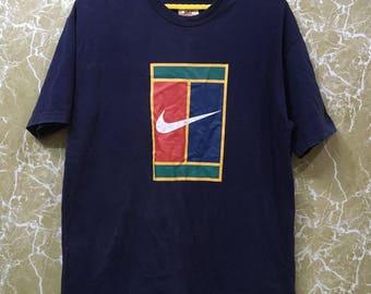 Vintage 90s Nike tennis t shirt L size blue colour