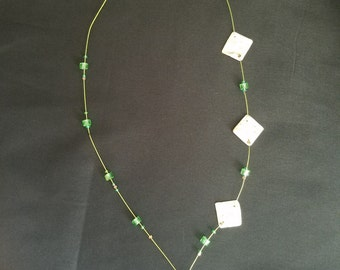 Green necklace with pearl shell from France.