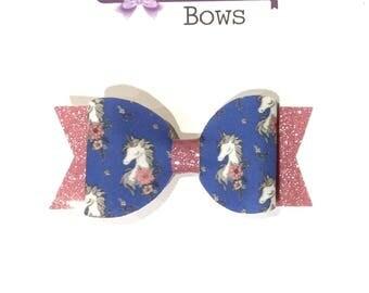 Blue Unicorn hair bow.
