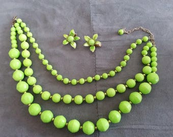Vintage three strand beaded necklace and clip on earrings. Green, flower earrings.