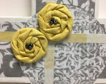 "Large Wood Cross art,  Gray/White print with 2 yellow fabric rosettes and silver beads, yellow and white detailing 16.5"" x 10.5"""