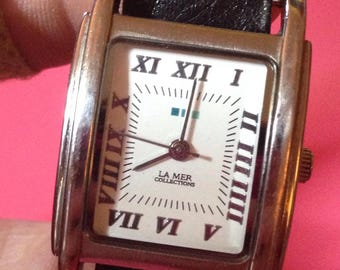 La Mer Collection Wrap watch black/silver studded wrap watch. Very funky