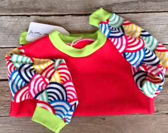 Red fleece jumper rainbow sleeves