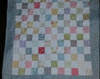 Crib sized checkerboard quilt