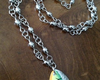 Long necklace with fishing lure pendant