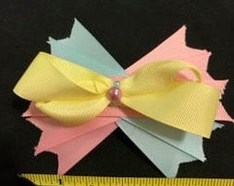 bow with pastel yellow pink and blue