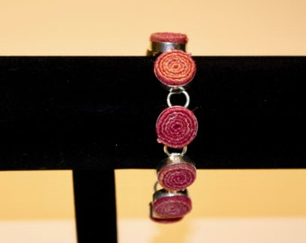 Silver plated braclet with hand dyed wool, 8.5 inches long with T clasp.