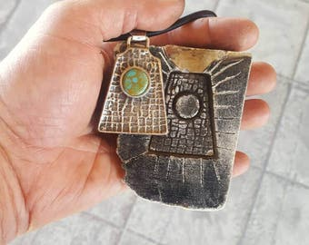 1 of a kind tufa cast pendant.
