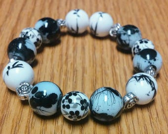 Black White and Gray Beaded Stretch Bracelet with Flower design on beads