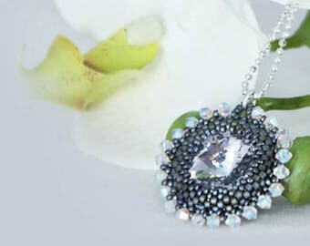 Pendant with Swarovski crystals and matte silver glass beads with sterling silver chain