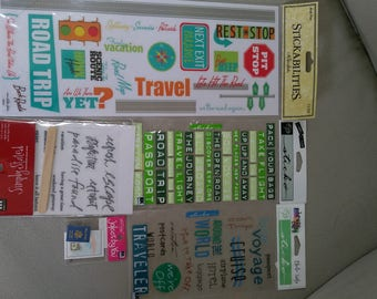 Assorted travel stickers and embellishments