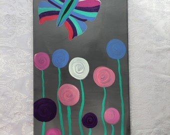 Abstract butterfly and flowers.  Acrylic on canvas handmade and hand painted.