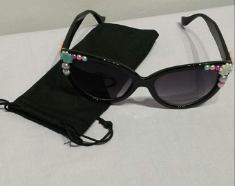 Womens black decorated floral sunglasses, love heart, bows.