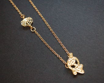 Gold tone spiderman necklace