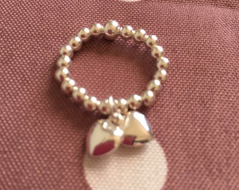 Sterling silver stretch ring with double heart charm