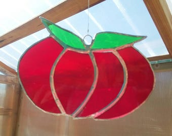 Stained glass tomato suncatcher.   Red glass garden tomato with green glass leaves and silver colored solder.  5 in by 4 in.