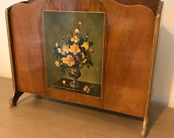 Vintage wooden floral motif magazine paper rack