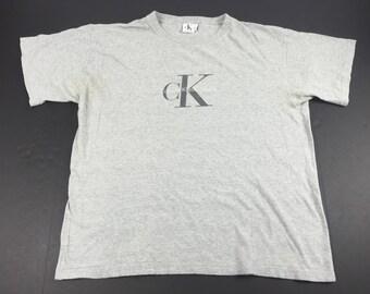 Vintage 90s Calvin Klein Jeans logo t-shirt mens L/XL