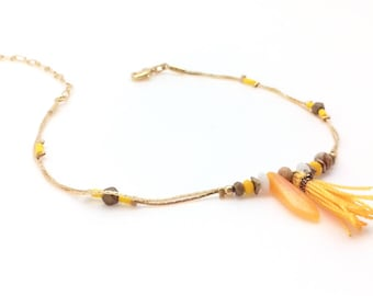 Golden, ethnic ankle chain, beads, stones and yellow Pompom.