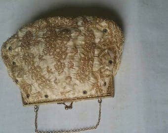 Antique  ivory gold silk beaded French purse.I've just lowered the price if that helps anyone interested. Thanks