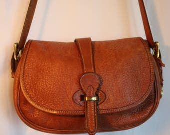 Dooney and Bourke Brown pebbled leather saddle bag messenger bag genuine leather 1980s cross body bag w brass buckles & insane fabulousness