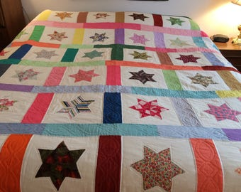 Vintage star quilt / hand appliquéd / hand quilted / pinks purples greens / 42 squares with stars