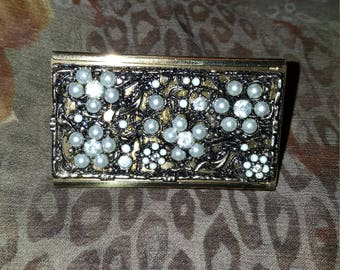 Vintage lipstick holder with sliding mirror . Beautifully detailed with faux pearls and rhinestones.