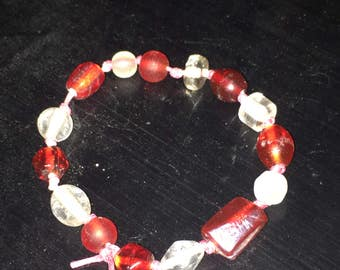 7in red and white bracelet on pink braid cord
