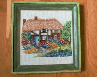 Cross stitch picture. House in battle.