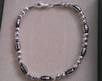 Sterling Silver Diamond cut beads with Blackend Oval Mirror Cut Beaded bracelet
