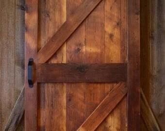 Reclaimed wood barn door with hardware