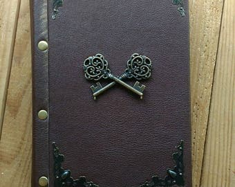 Vintage notebook with keys. Handmade.Craft sheets. Leather