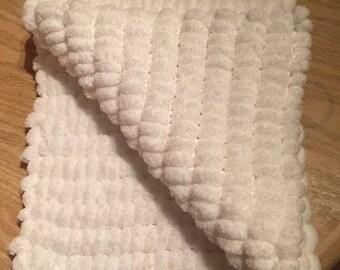 Beautiful soft hand knitted baby pram blanket in Rico pom pom wool
