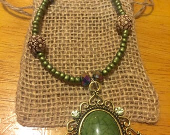 jade green pendant with beaded accents