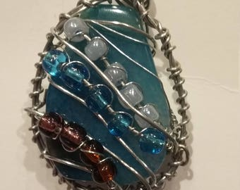 Turquoise handwrapped in stainless steel